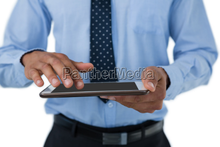 mid section of businessman touching tablet