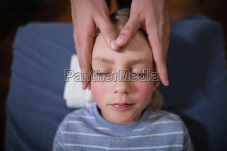 overhead view of boy receiving head