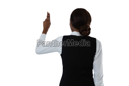 rear view of businesswoman using invisible