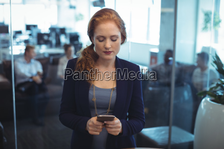 young businesswoman using mobile phone at