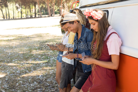 side view fiends using mobile phone