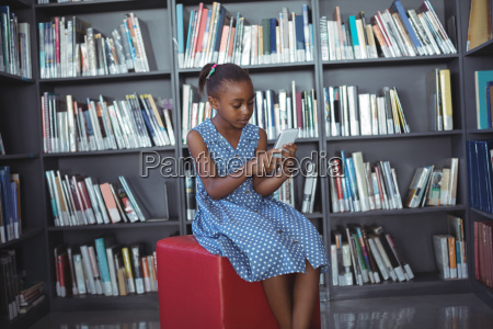 girl using mobile phone while sitting