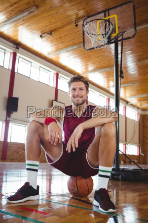 portrait of basketball player sitting on