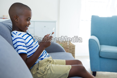 side view of smiling boy using