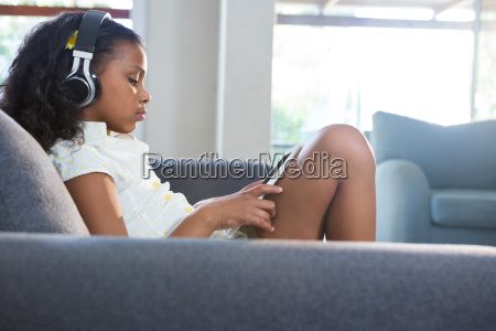side view of girl listening music