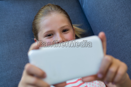 overhead view of girl using phone