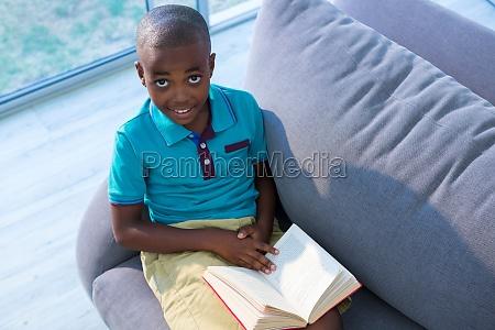 high angle portrait of boy sitting