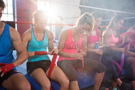 back lit athletes sitting on boxing