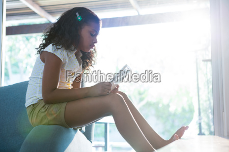 side view of girl using tablet