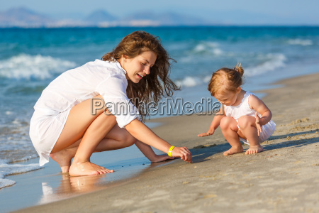 mother and daughter playing on the