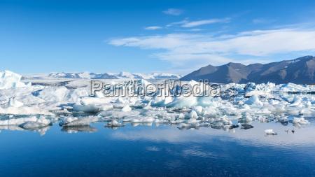 view of icebergs in glacier lagoon