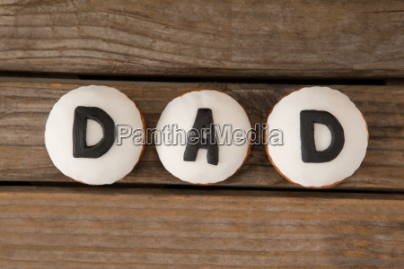 cookies with black dad text on