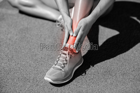 low section of sportswoman suffering from