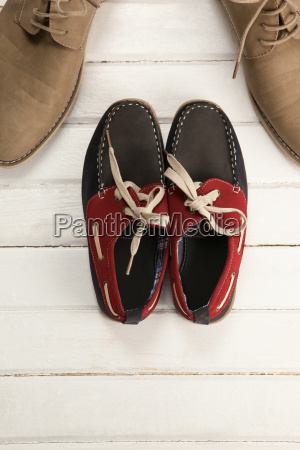 loafers with shoes on white floor