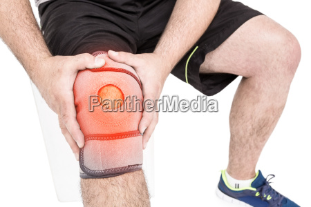 man suffering with knee inflammation