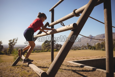 girl exercising on outdoor equipment during