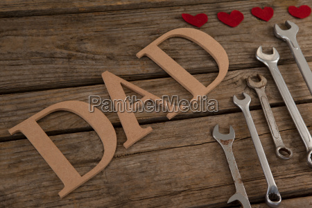 various wrenches and text dad on