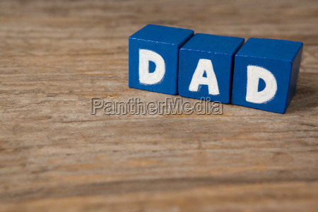 blocks with text dad on wooden