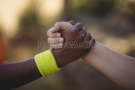 close up of athlete holding hands