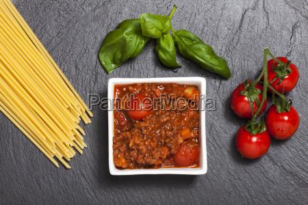raw spaghetti on black slate