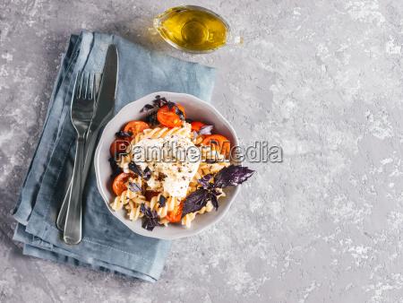 pasta fusilli with cherry mozarella and