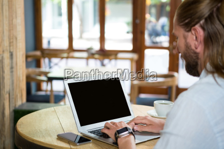 side view of man using laptop