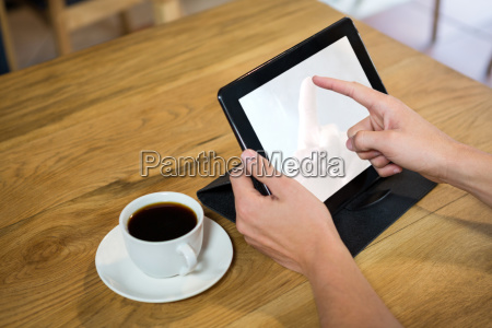 man using digital tablet with blank