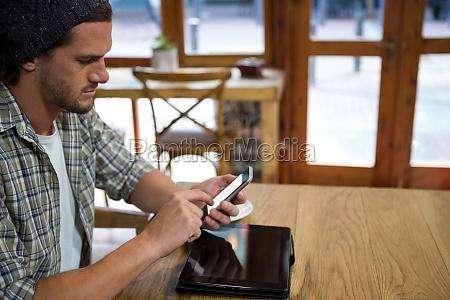 young man using smart phone at