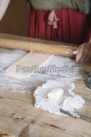 close up of woman preparing dough