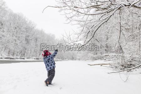 boy wearing furry hat standing near