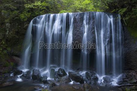 long exposure of rocky waterfall in