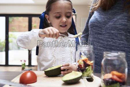 portrait of little girl preparing healthy