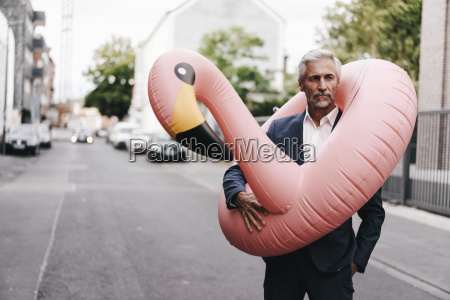 mature businessman on the street with