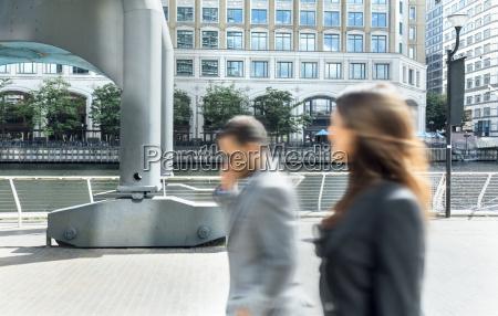 london uk businesspeople walking through the