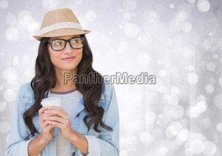woman in fedora with white coffee