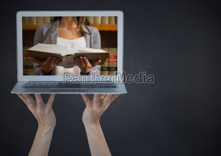 hands with laptop showing woman reading