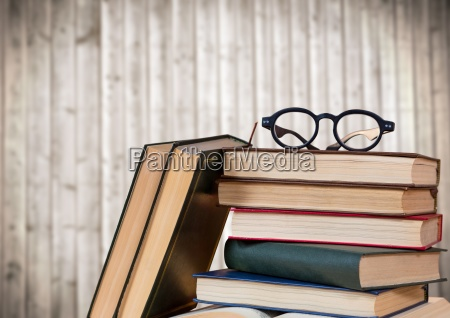pile of books and glasses against