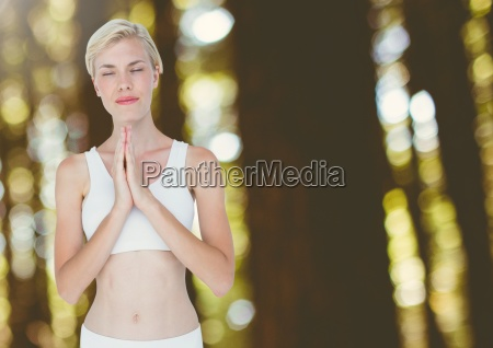 woman meditating yoga peaceful praying in