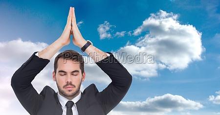 businessman meditating yoga in front of