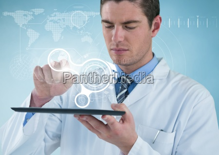 man in lab coat with tablet