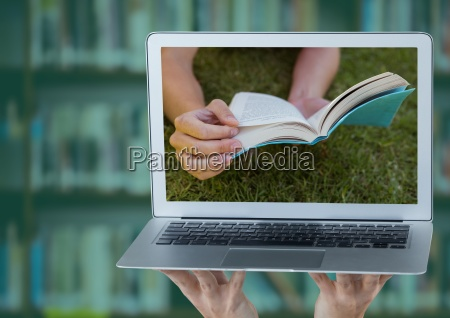 hands with laptop showing book on