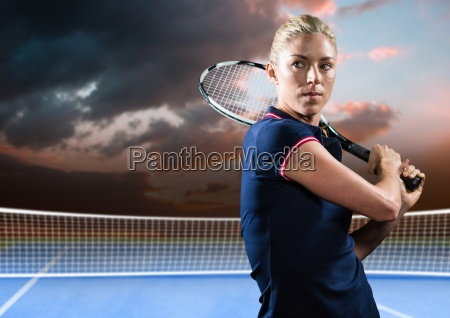 tennis player on court with evening