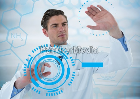 man in lab touching blue interfaces
