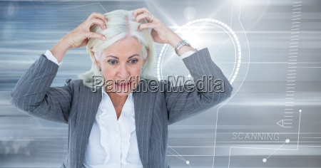 stressed older woman with technology interface