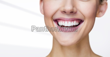close up of woman smiling against