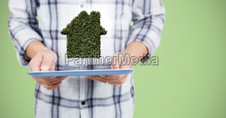 man mid section with tablet and