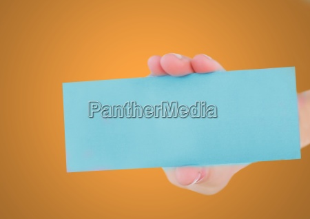 hand holding blank blue card against