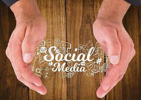 hands around white social media doodles