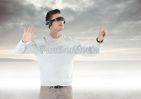 man using virtual reality glasses against