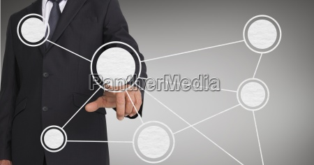 mid section of businessman touching digital